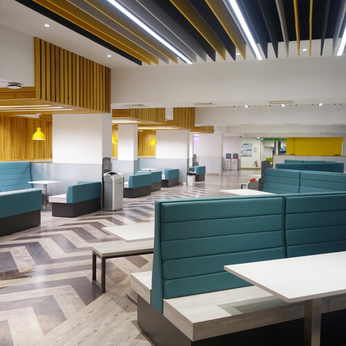 Barton Peveril College high back sofas soft seating in dining area