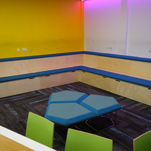 Barton Peveril College breakout area with upholstered bench seating and connection platforms